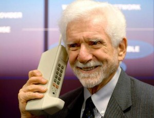 Inventor Martin Cooper holds one of the first mobile phones in this undated handout photo.